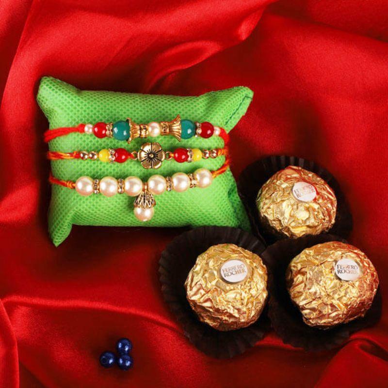 Pearly Set Of Three Rakhis With Ferrero