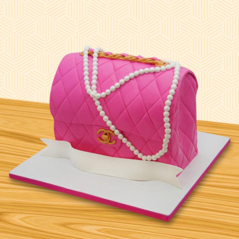 Chanel pink designer cake