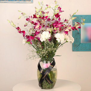 Pretty Orchids N Carnations Bouquet - Arrangement if 6 Purple Orchids and 10 White Carnations with Glass Vase