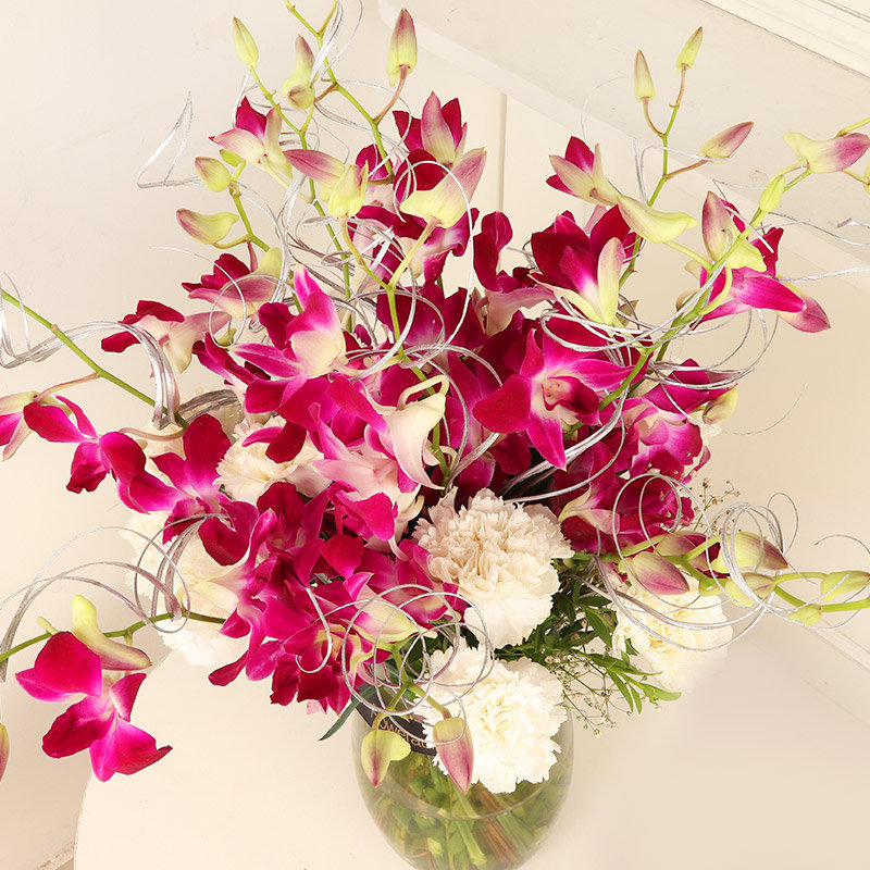 Pretty Orchids N Carnations Bouquet