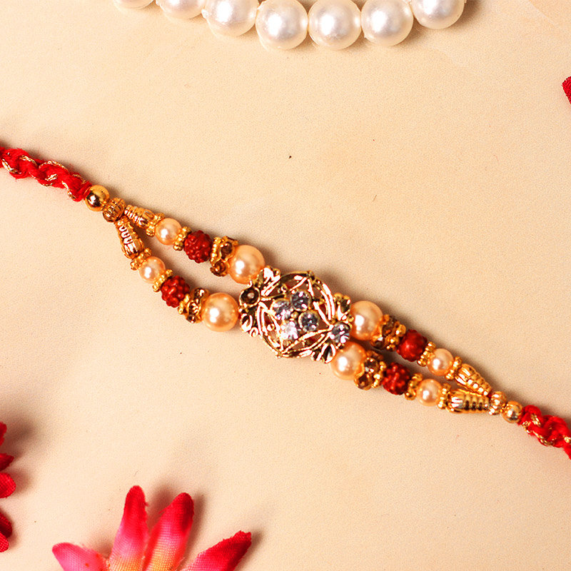 Pretty Pearl Rudraksha Rakhi - One Rudraksh Rakhi with Roli Chawal