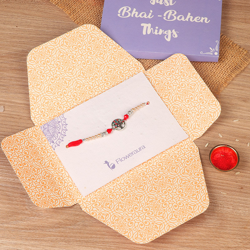 Product in Rakhi Gifts for Brother Online - Rainbow Stone Rakhi