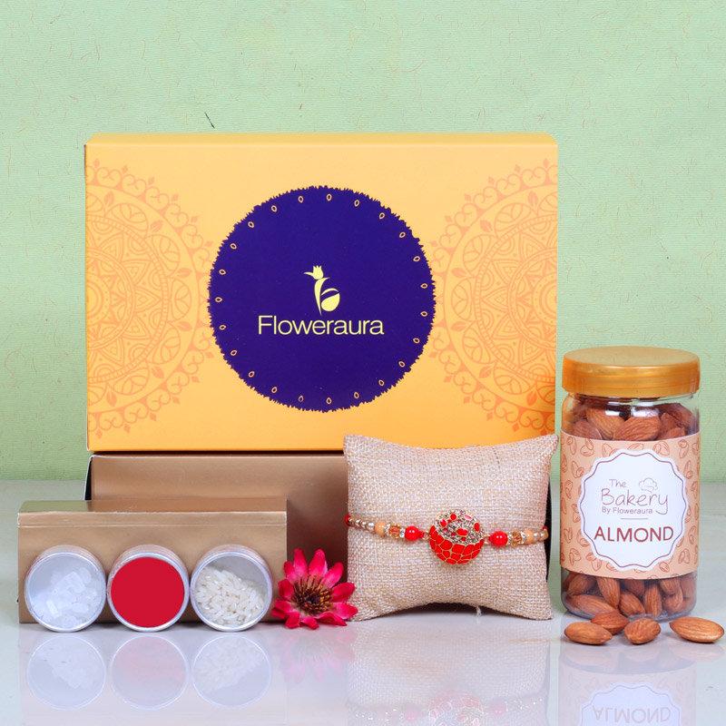 Rakhi N Almonds Hamper - One Designer Rakhi with Roli and Chawal and Almonds and One Floweraura Signature Box