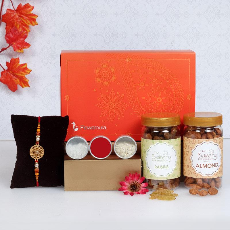 Rakhi Signature Box With Raisins N Almonds - One Metal Rakhi with Roli and Chawal and Raisins and Almonds and One Floweraura Signature Box