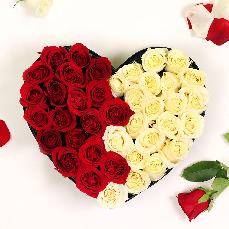 Heart Shaped Arrangement of Red and White Roses