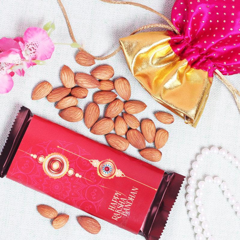 Rich Almond Rakhi Combo - Cadbury Temptation Wrapped with Raksha Bandhan Wrapper and 100gm Almonds in Pink Potli