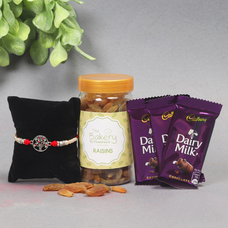 Rich Rakhi Hamper - One Designer Rakhi with Complimentary Roli and Chawal and 100gm Raisins in Colorful Floweraura Container and 3 dairy milk chocolates