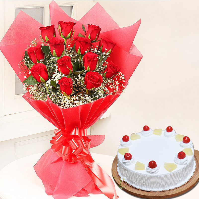 Rosey Cakey Combo - Bunch of 12 Red Roses with 500gm Pineapple Cake