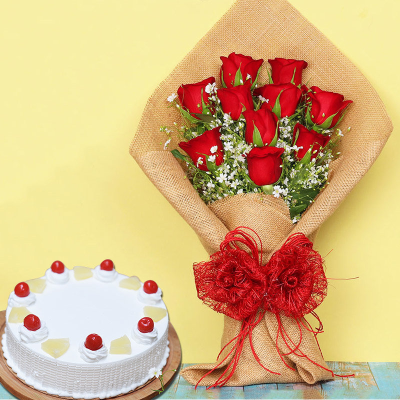 Rosey Pineapple Combo - Bunch of 10 Red Roses in Jute Wrapping with 500gm Pineapple Cake