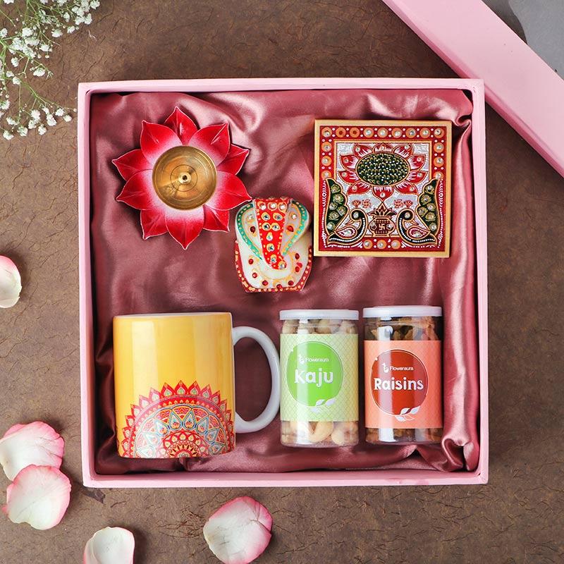 Lord Ganesha on chauki, coffee mug, lotus diya & dry fruits Buy Now