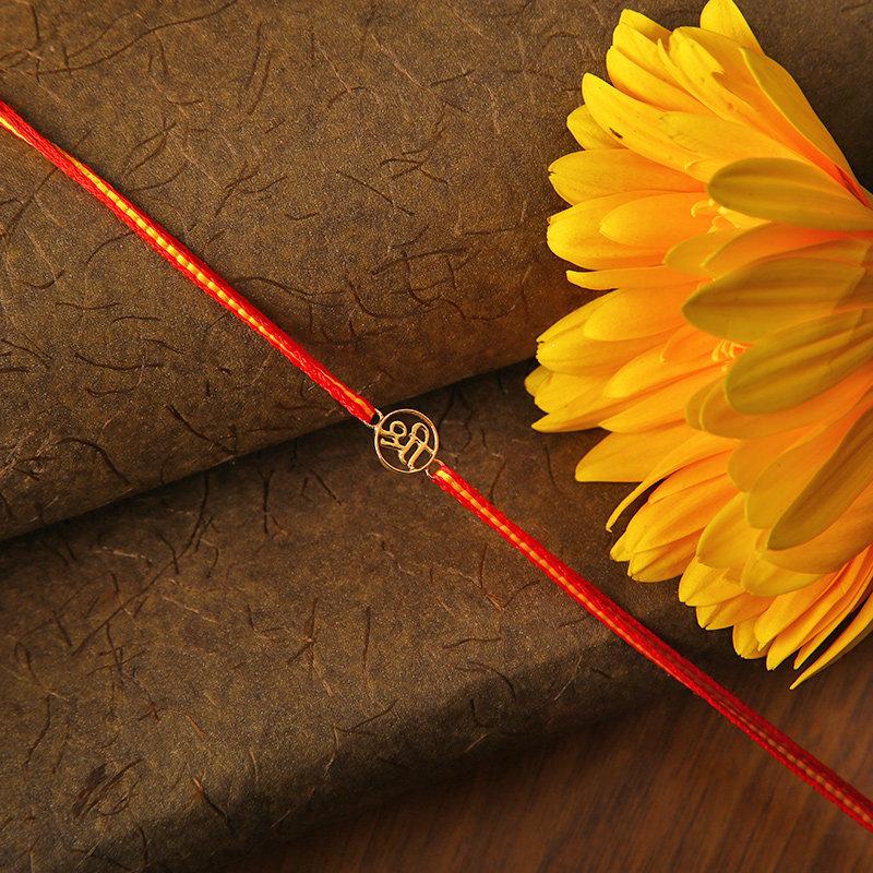 Buy Gold Designer Rakhi Online From FlowerAura
