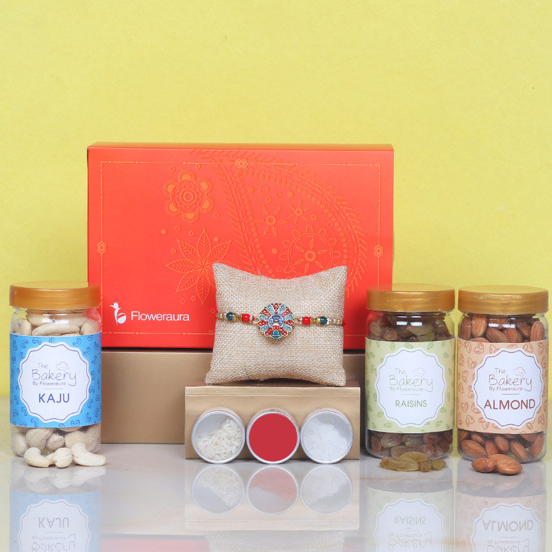 Siblingship Signature Box - One Metal Rakhi with Roli and Chawal and Cashews and Almonds and Raisins and One Floweraura Signature Box