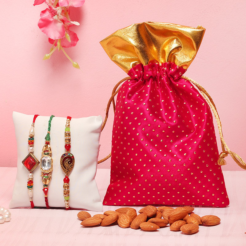 Stone N Almond Combo - Set of 3 Designer Rakhi with Complimentary Roli and Chawal and 100gm Almonds in Pink Potli