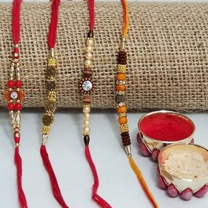 4 Rudraksha Rakhi Set - Set of 4 Designer Rakhis and Roli Chawal