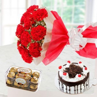 Carnation bunch with black forest cake and Ferrero Rocher chocolate - A delightful combo