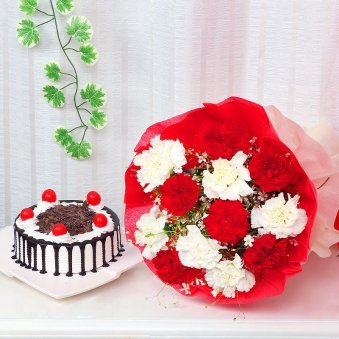 Reindeers Special - A gift combo of red and white carnation with half kg black forest cake