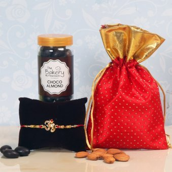 Almondy Choco Rakhi Hamper - One Divine Rakhi with Complimentary Roli and Chawal and 100gm Choco Almonds in Metallic Container and One Potli
