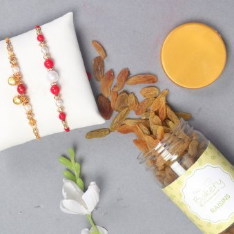 Bead Rakhi N Resins Combo - Set of 2 Designer Rakhi with Complimentary Roli and Chawal and 100gm Raisins in Colorful Floweraura Container