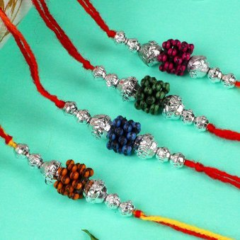 Beautiful 4 Rakhi Set - Set of 4 Designer Rakhis A Complementary Pack of Roli and Chawal