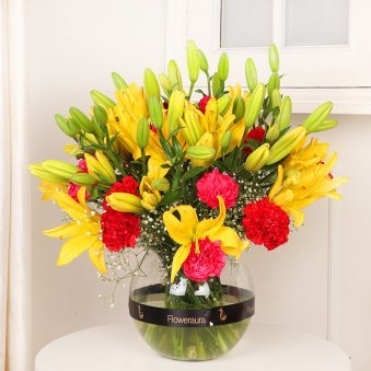 Carnation Lily Combination - Arrangement of 10 Yellow Lilies and 10 Red and Pink Carnations with Round Vase