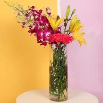 Charming Mixed Flowers In A Vase - Premium Bouquet of 12 Flowers with 6 Red Carnations and 2 Yellow Lilies and 4 Pink Orchids