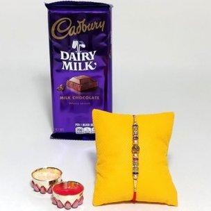 Chocolatey Rakhi Combo - One Designer Rakhi with Dairy Milk Chocolate Bar and Roli Chawal