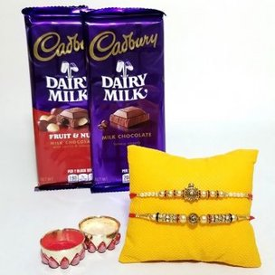 Delicious Rakhi Combo - A Desginer Set of 2 Rakhis with Dairy Milk Fruit N Nut and Dairy Milk Chocolate Bar