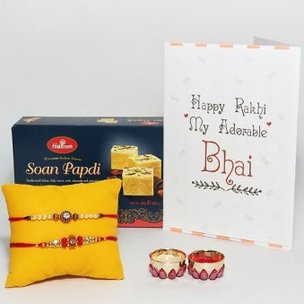 Delightful Rakhi Combo - A Desginer Set of 2 Rakhis and 250 gram Haldiram Soan Papdi with Greeting Card for Brother and Roli Chawal
