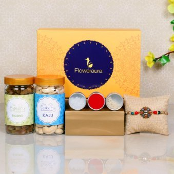 Dry Fruit Rakhi Signature Box - One Diamond and Metal Rakhi with Complimentary Roli and Chawal and 100gm Raisins in Plastic Container and 100gm Cashews in Plastic Container and One Floweraura Signature Box