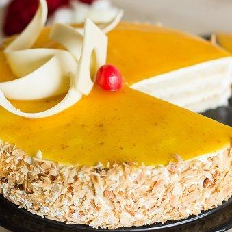 Zoom view of Nutty Mango Birthday Cake