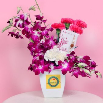 Arrangement of Orchids and Carnations with Rakhi for Brother