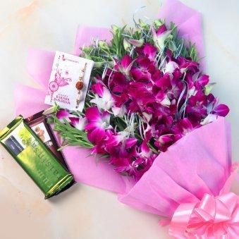 Rakhi With Flowers - Rakhi With Six Orchids N Two Cadbury Temptations