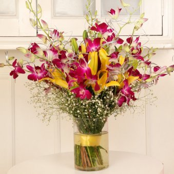 Orchids In A Vase - Arrangement of 6 Pink Orchids and 4 Yellow Lilies with Glass Vase