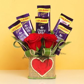 Chocolates and Roses in a Glass Vase