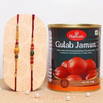 Two Designer Rakhis with 1 Kg Haldiram Delicious Gulab Jamun