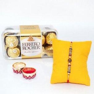 Sweet n Beauty Rakhi Combo - One Designer Rakhi and Pack of 16 Ferrero Rochers with Roli Chawal