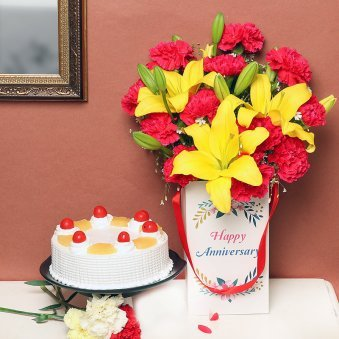 Carnations & Lilies Bunch in Anniversary Flower Box with Pineapple Cake