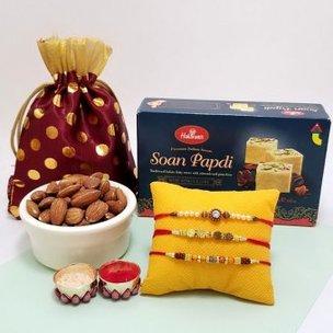 Trinity Rakhi Combo - A Desginer Set of 3 Rakhis and 100 grams Almonds with 250 gram Haldiram Soan Papdi and Roli Chawal