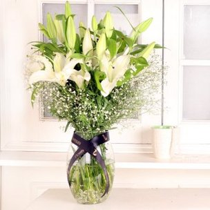 White Lily Breath - Arrangement of 7 White Lilies in Glass Vase