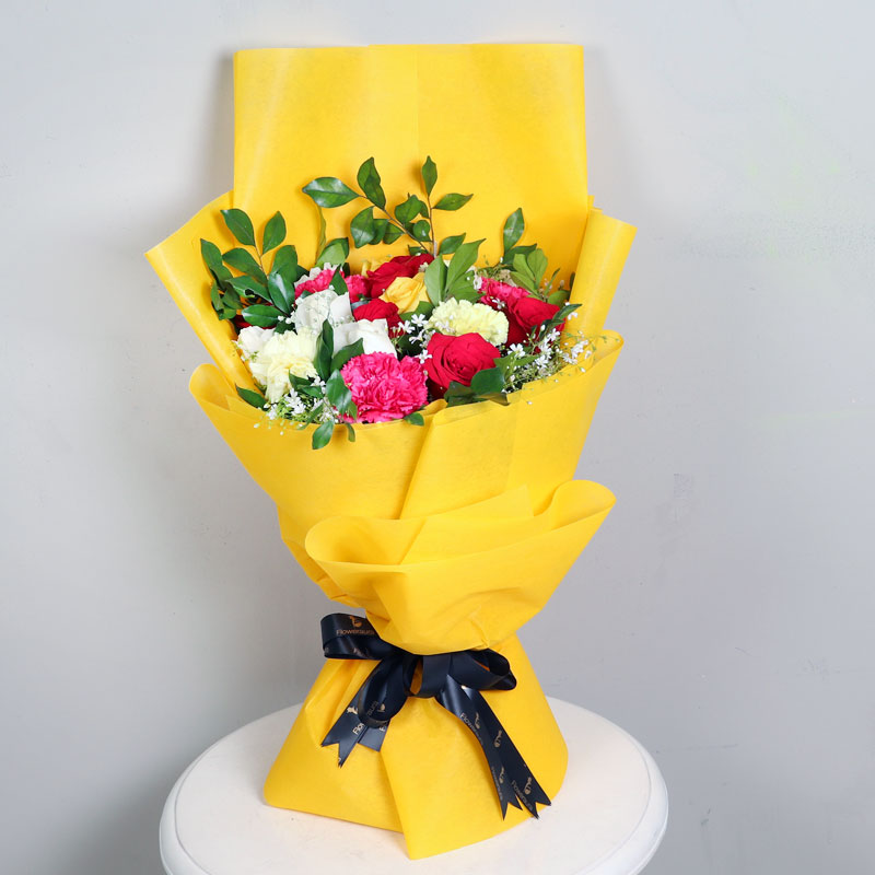Sunkissed Wrapped Smiles - Bouquet of 19 Mixed Flowers in Golden and Yellow Paper Packing