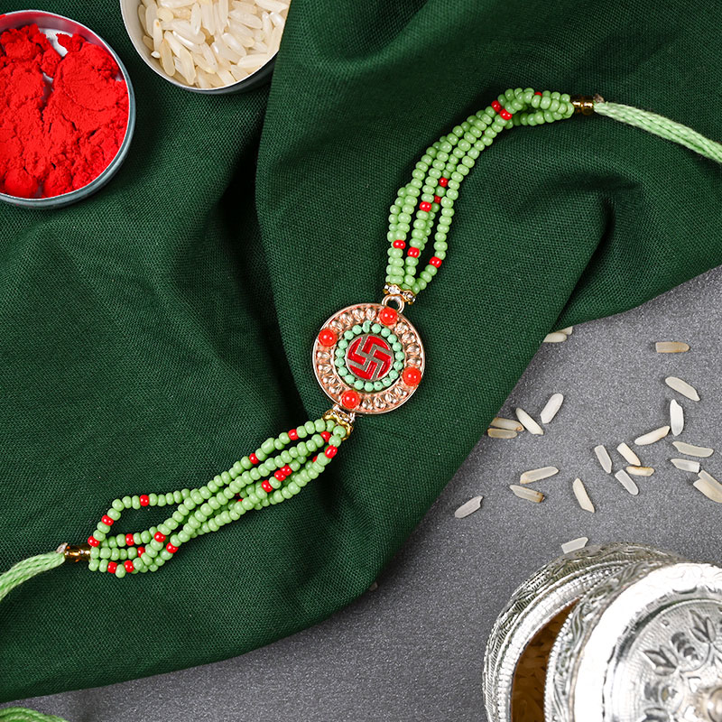 Swastika Beads Bliss Rakhi Online - Divine rakhi, Swastik Rakhi