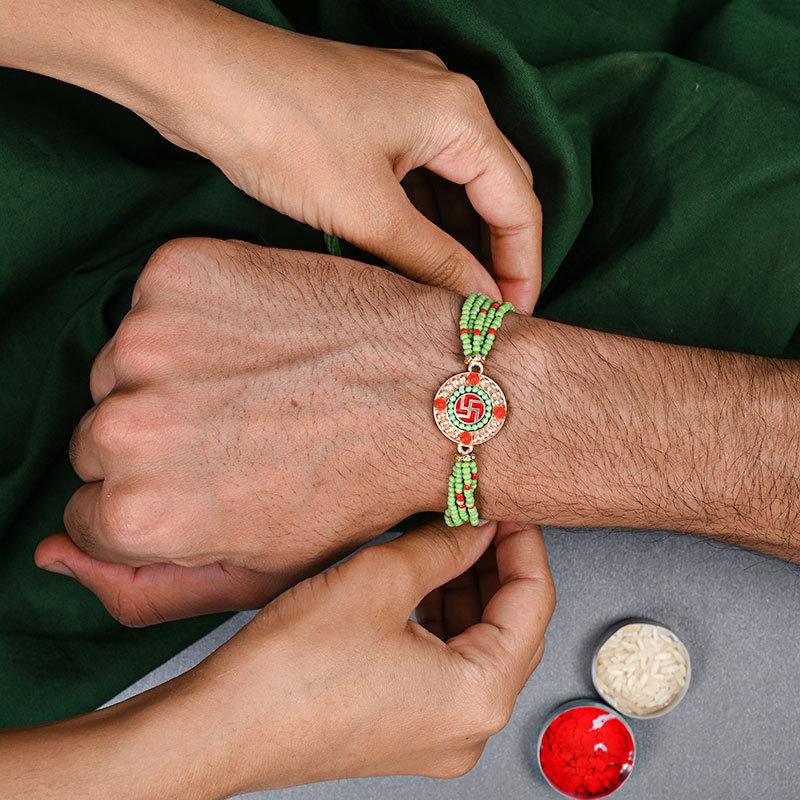 Swastika Beads Bliss Rakhi on hand