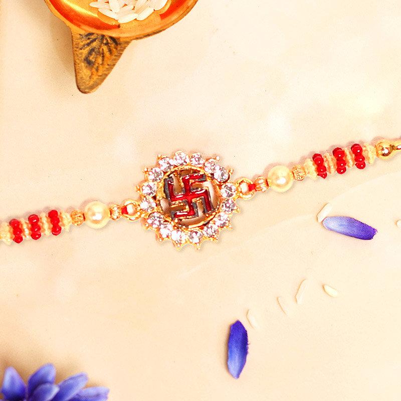 Swastika Pearl Rakhi - One Divine Rakhi with Roli Chawal