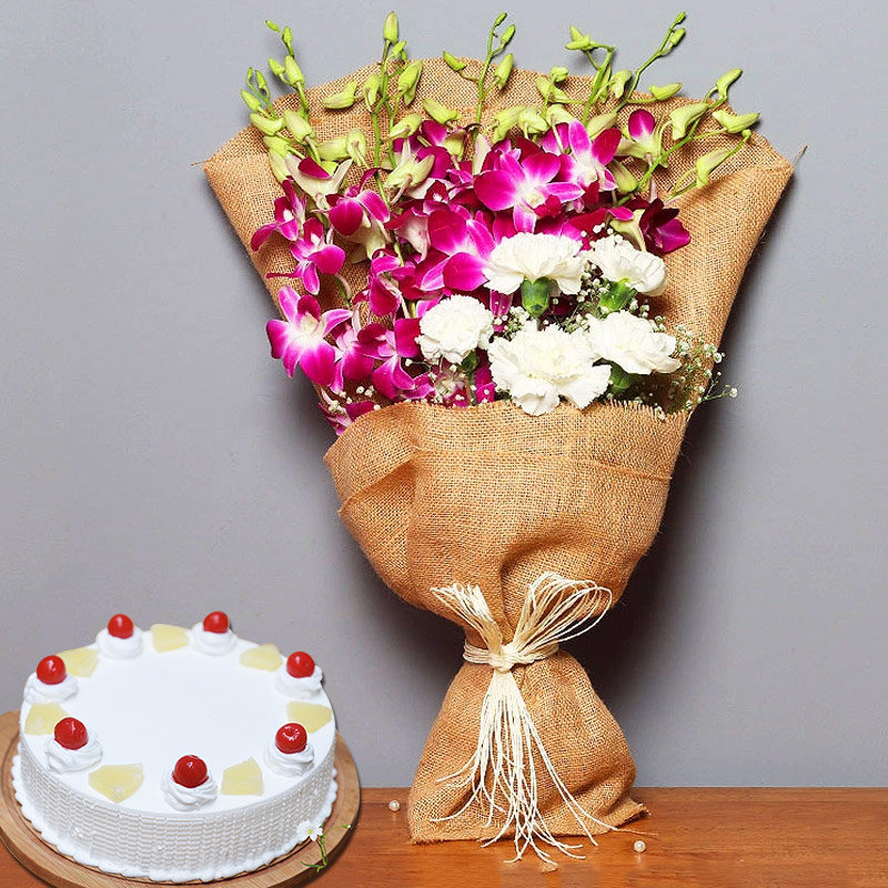 Sweet Affectionate Hamper - Jute Wrapped Bouquet of 6 Orchids and 5 White Roses with 500gm Pineapple Cake