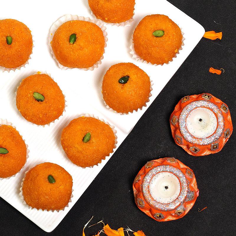 Sweet Temptation - 2 Designer Diyas and Half Kg Motichoor Ladoo