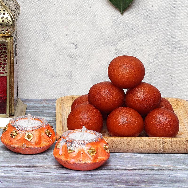 Sweetilicious Combo - 1 Kg Haldiram Gulab Jamun with 2 Designer Diyas