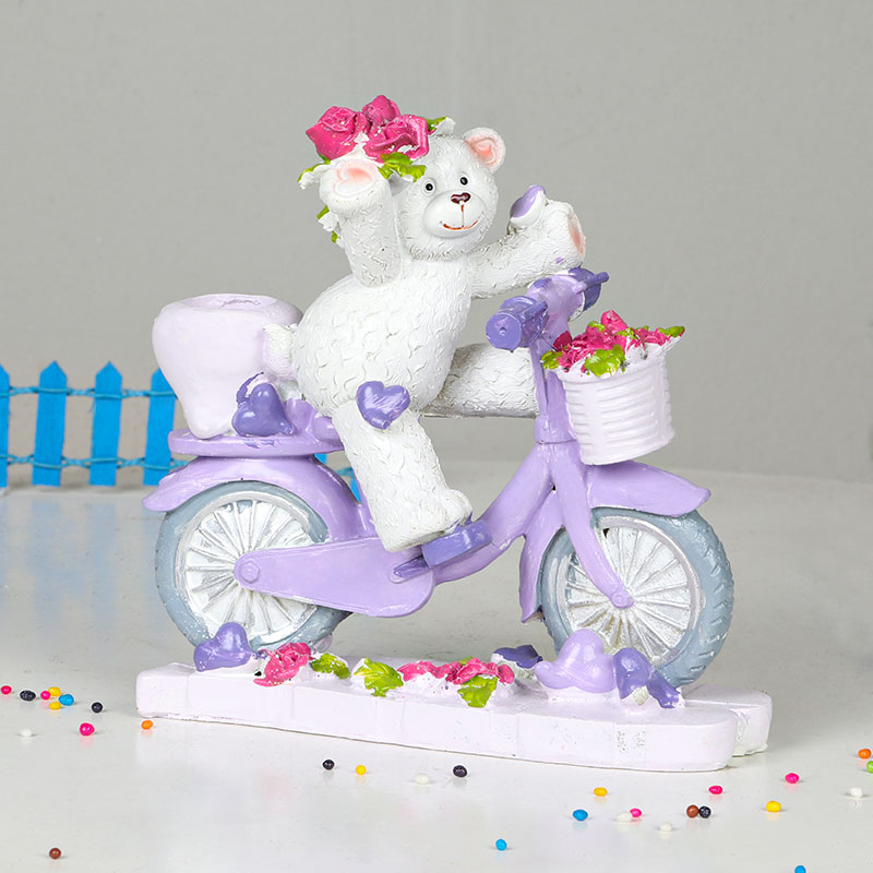 Teddy On Bicycle Statue