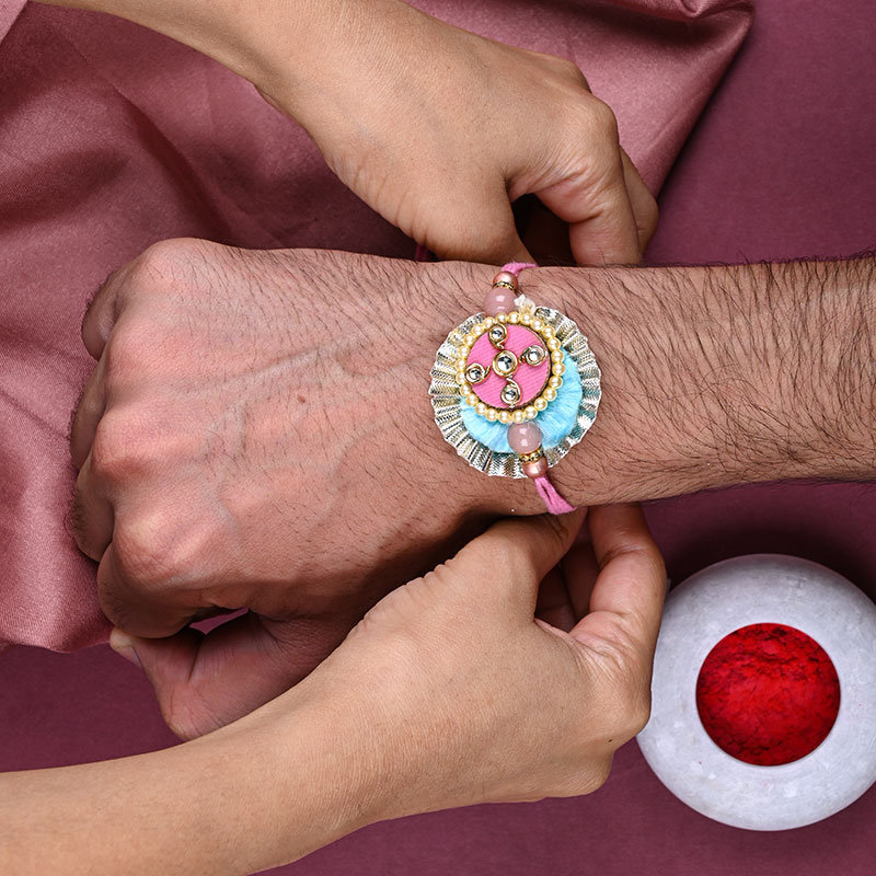 The Craftpiece Colorful Rakhi Tied on Hand