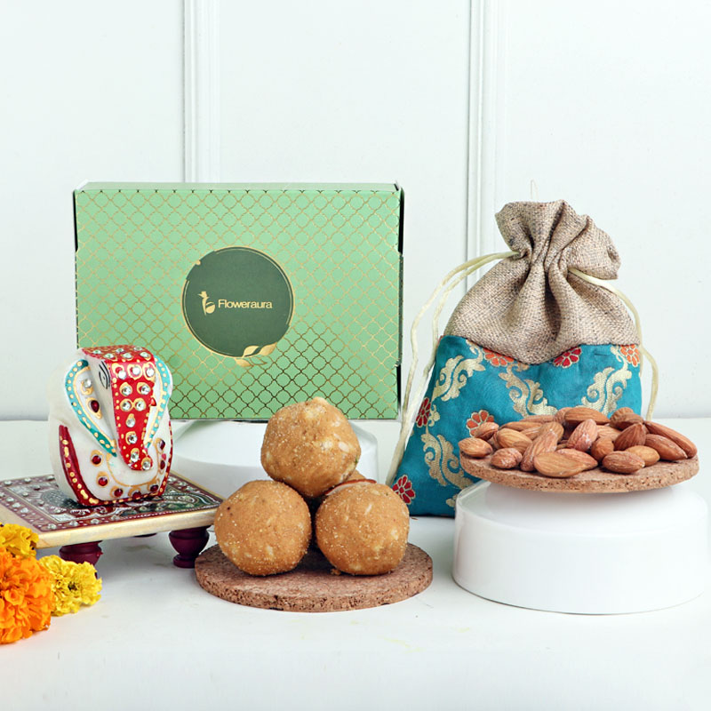 A bag filled with Almonds and Ganesha Idol