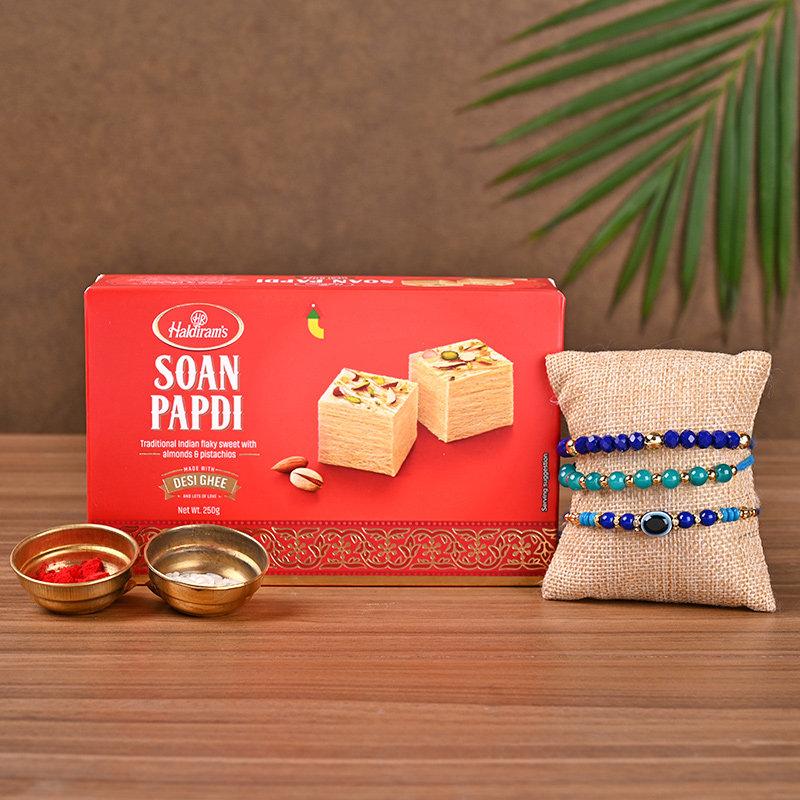 Three Designer Rakhi And Sweet Treats